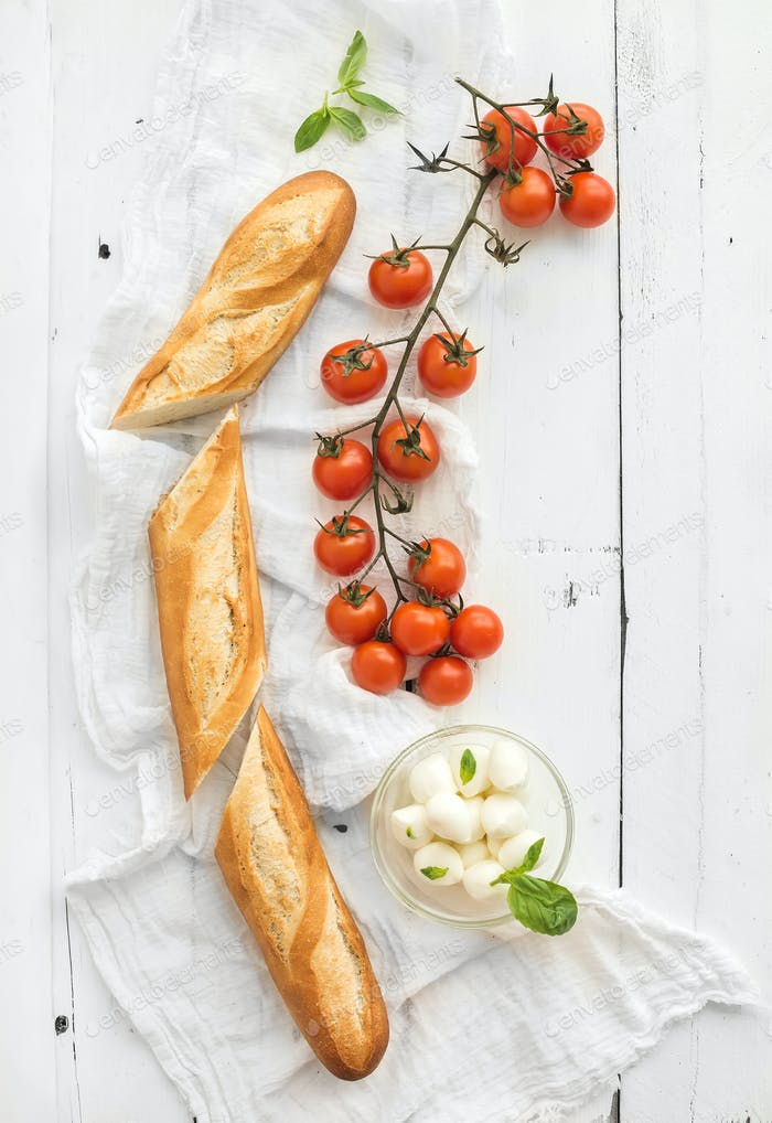 Baguette with banch of cherry-tomatoes, basil and mozzarella cheese