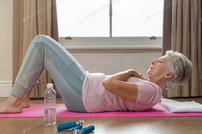 Senior woman doing sit ups