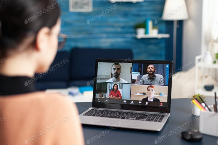 Student listening colleagues during online videocall school