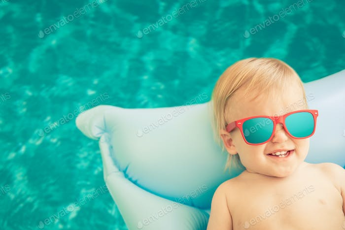 Funny baby boy on summer vacation