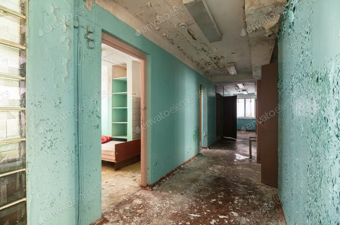 Corridor with open doors in an abandoned building