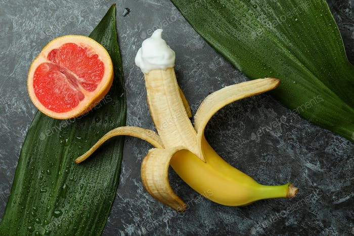 Sex concept with fruits on dark background