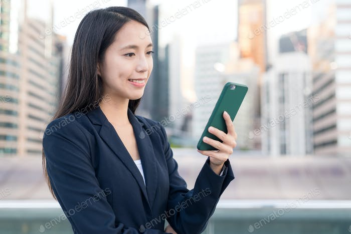 Business woman using mobile phone at outdoor