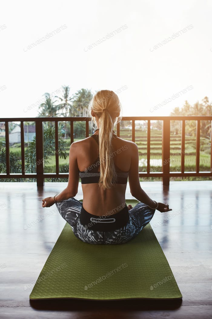 Fitness woman doing meditation at health club