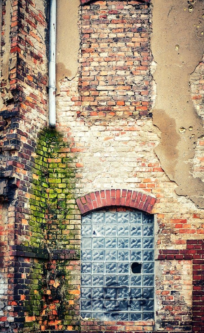 Demolished old brick building wall.