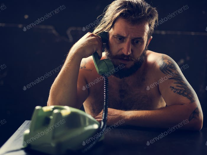 Man using telephone on tension talking