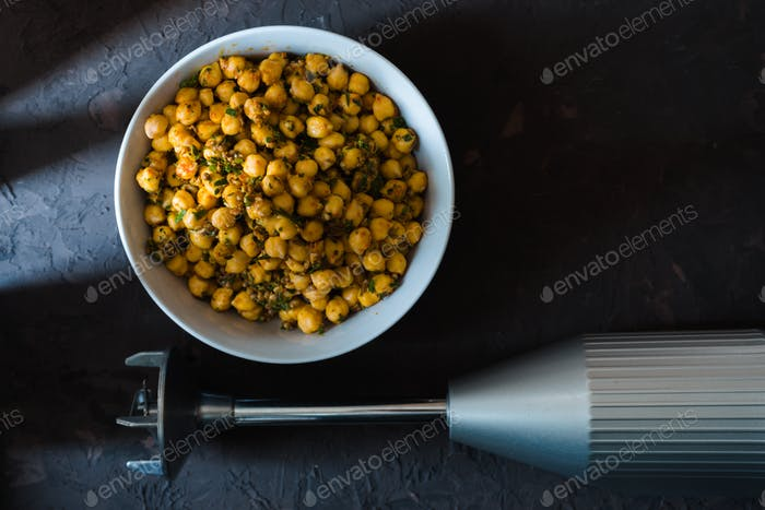 Chickpeas in a ceramic bowl and blender for making falafel free space