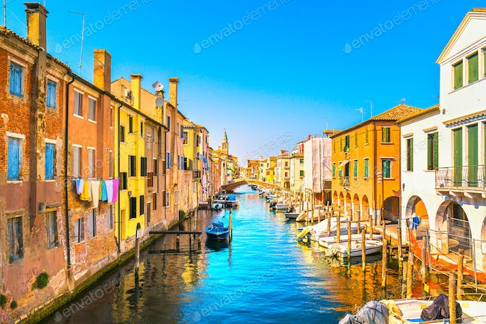 Chioggia town in venetian lagoon, water canal and church. Veneto