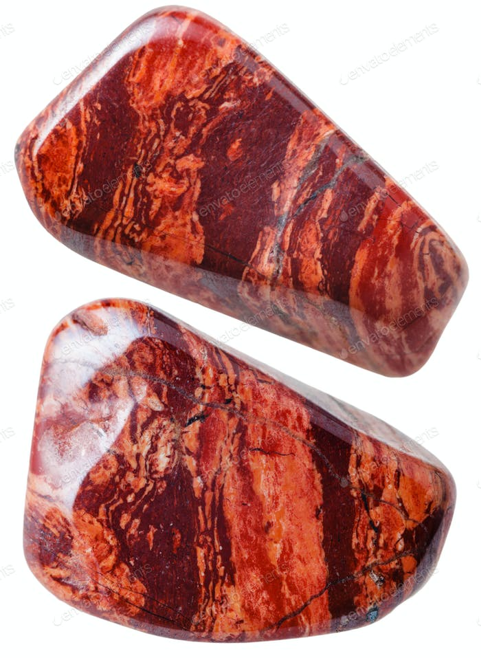 two red brecciated jasper gemstones isolated
