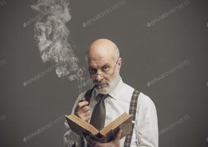 Senior academic professor reading and smoking a pipe