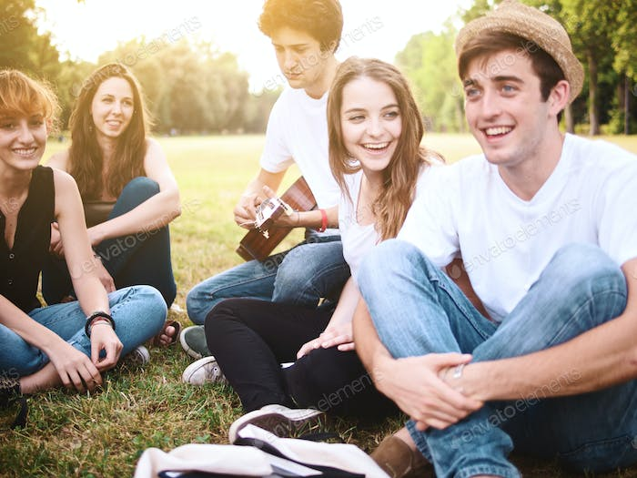 large group of students playing a music in a campus