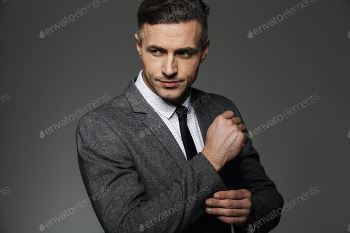 Photo of stylish man wearing business suit looking aside, while