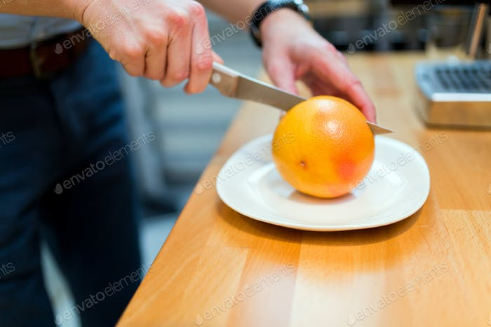 Orange being cut and pealed