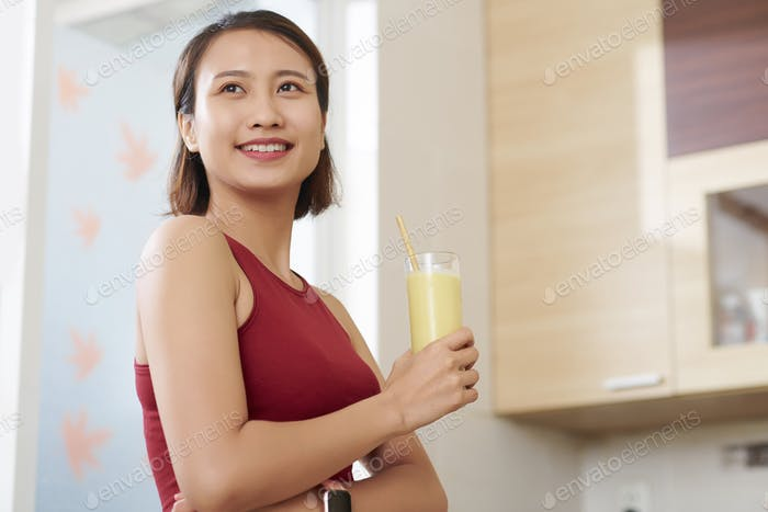 Vietnamese woman with banana smoothie