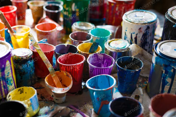 multicolored cans with paint, arts background