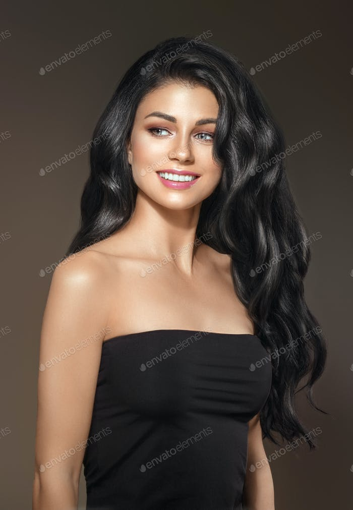 Woman with Black Long Hair and natural Make up over brown background