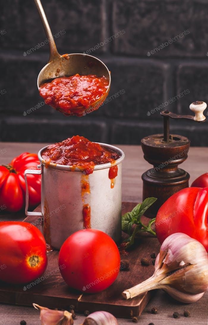 Mug of tomato sauce