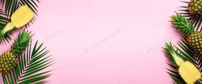 Pattern with bright pineapples, palm leaves on pink background. Top View. Copy Space. Minimal style