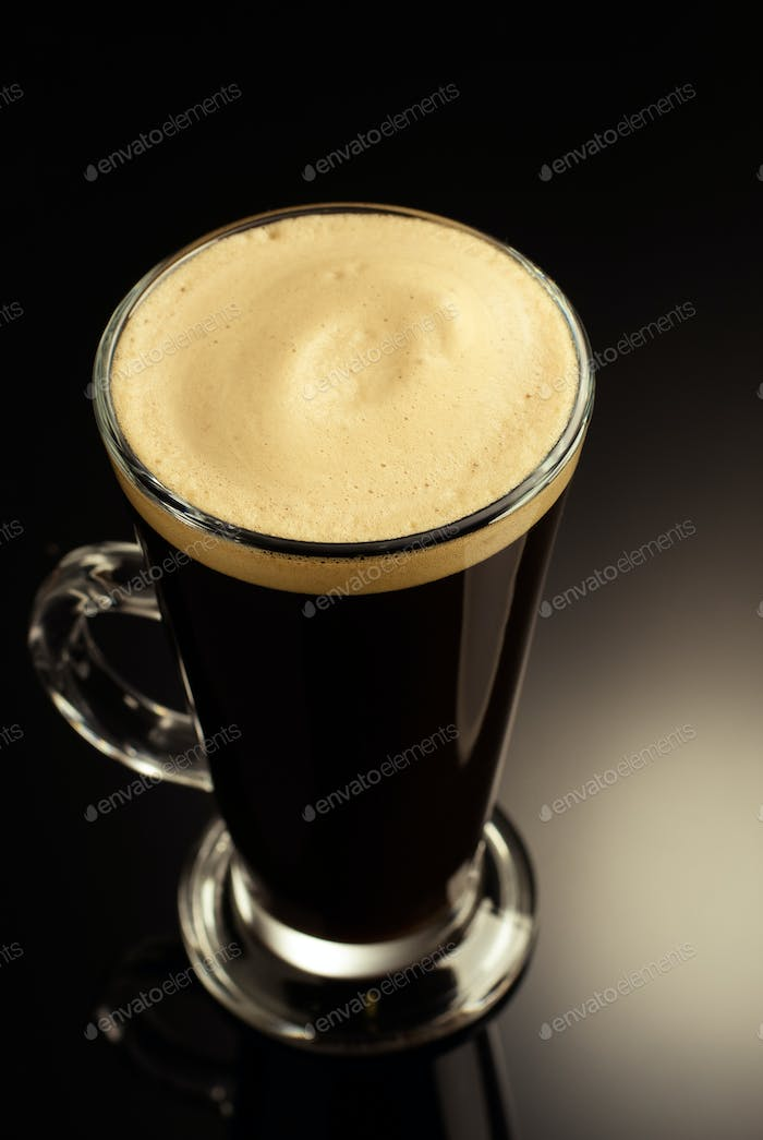 coffee in glass cup on black background