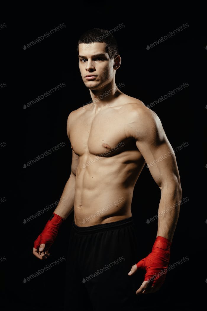 Portrait of male boxer posing