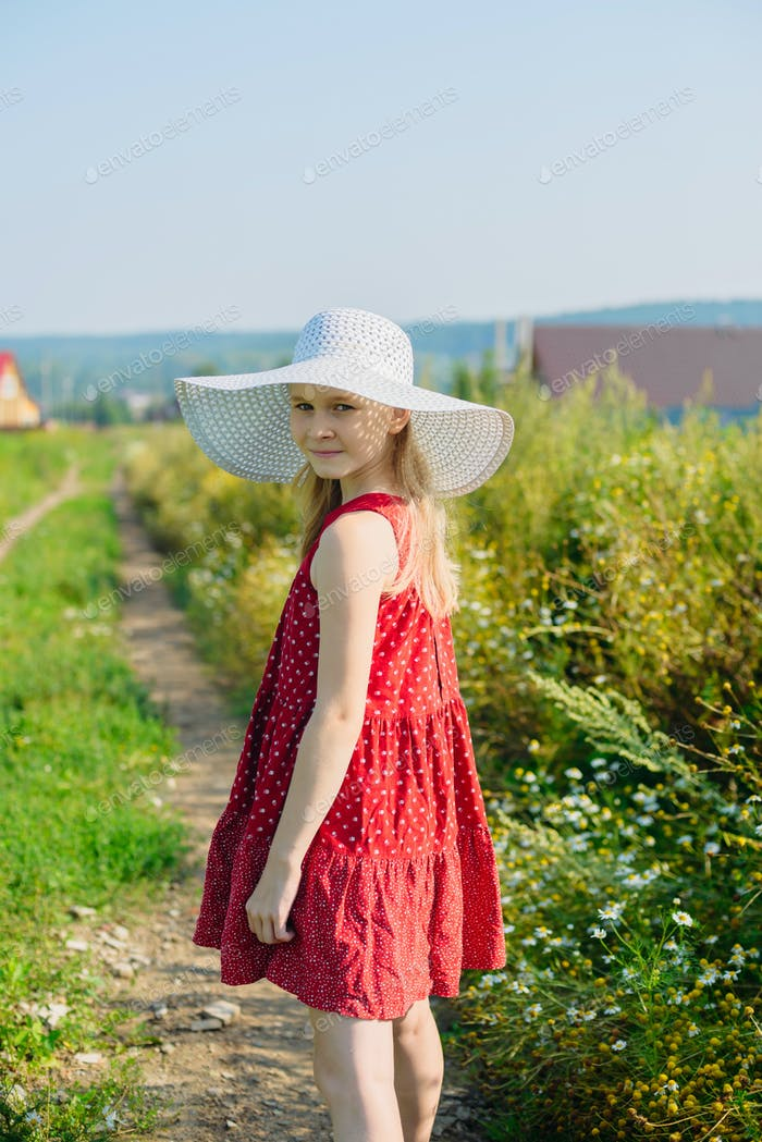 girl in red dress and white hat with large brim