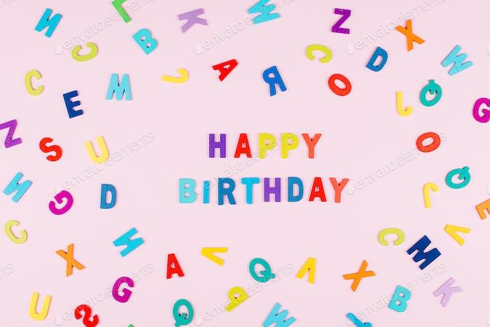 "Happy Birhday Card. Bright multicolored alphabet background with word ""Happy Birthday"". Flat lay"