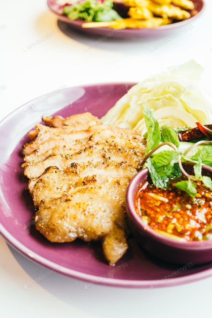 Grilled pork neck meat with spicy sauce