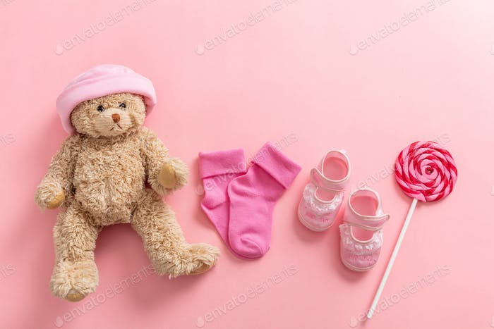 Baby girl shoes and socks on pink background