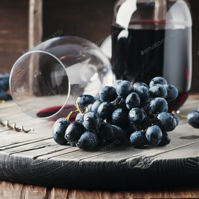 Fresh grape and red wine on the vintage table
