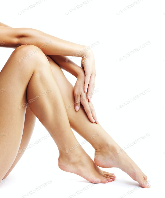 Woman's legs isolated on white background