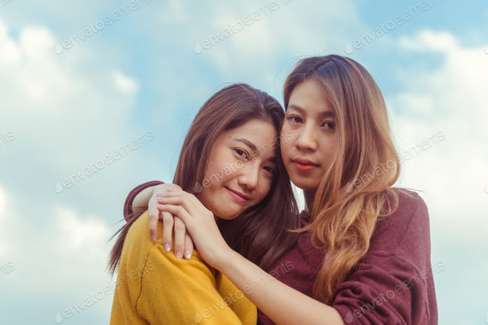 Lesbian women couple together outdoors concept.