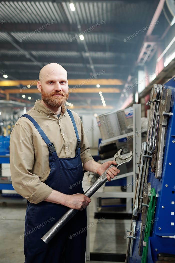 Man with big wrench