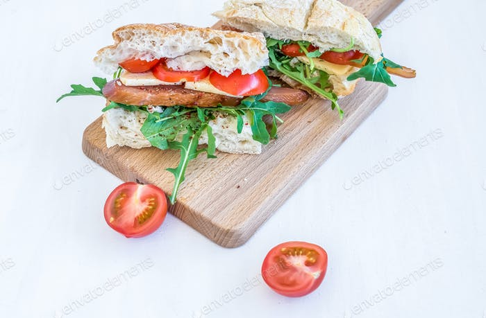 Sandwiches with chicken carpaccio, parmesan cheese, fresh cherry