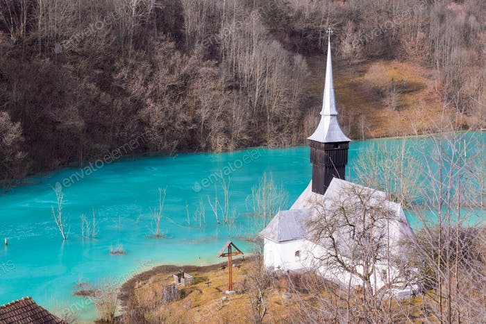 Church and flooded cemetery next to drowned village at Geamana lake near gold mine of Rosia Montana