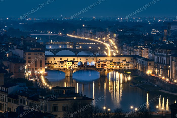 Ponte vecchio in Florence at blue hour with city lights on