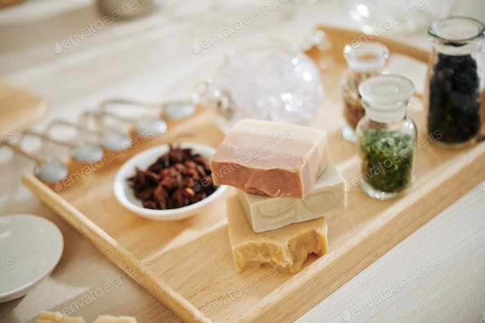 Soap bars on wooden tray