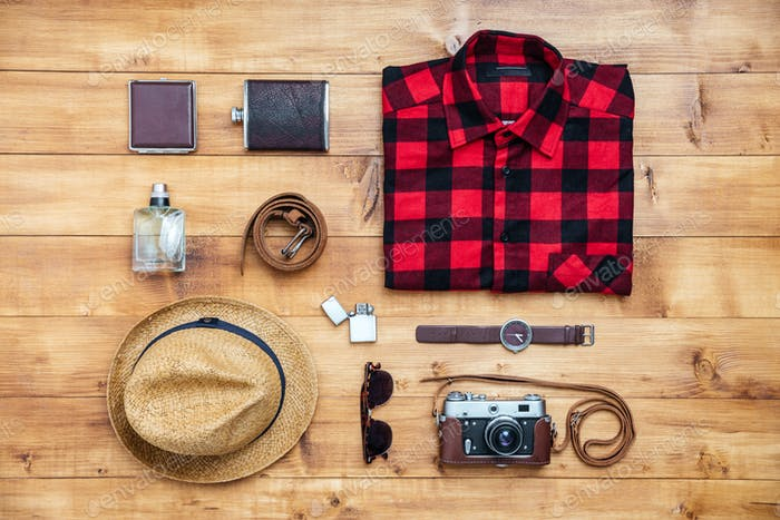 Travel concept shirt, camera, hat, flask, watch, eyeglasses, belt,wallet