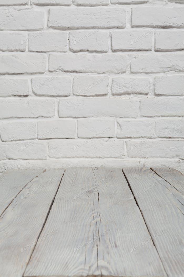 Alte weiße Ziegelmauer und Holzboden Hintergrund