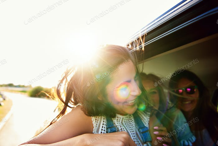 Laughing vivacious teenager traveling with friends