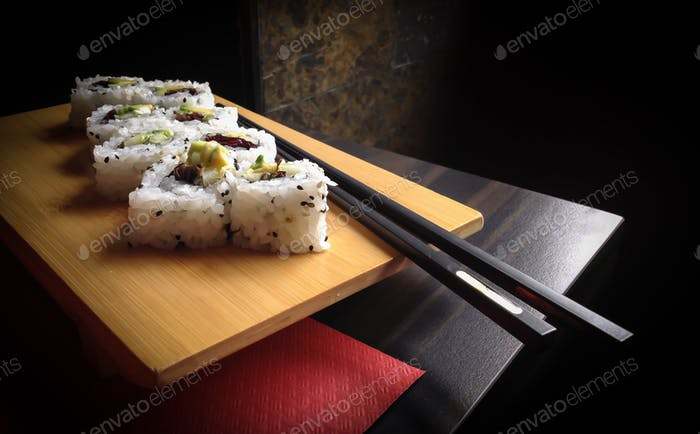 Sushi rolls with chopsticks