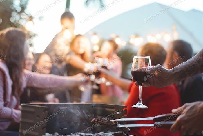 Happy family doing celebratory toast at barbecue party