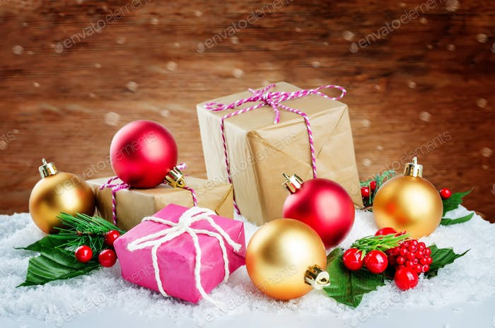 Christmas winter background with gifts, colored balls and christ