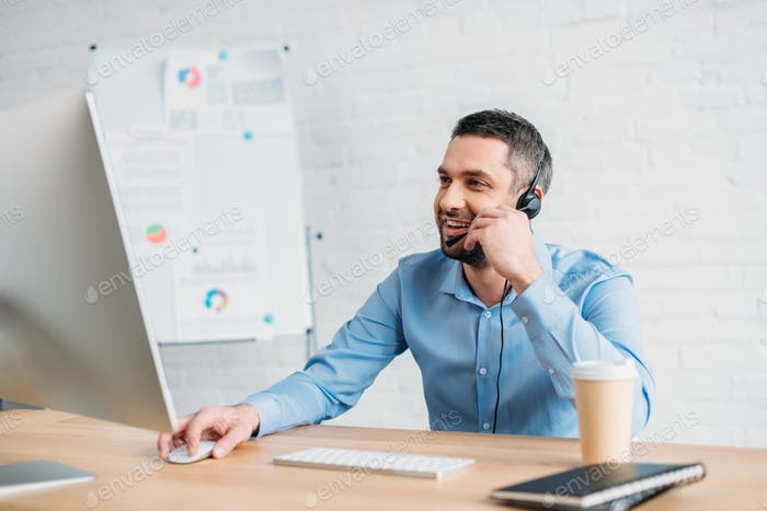 happy adult call center worker working at office