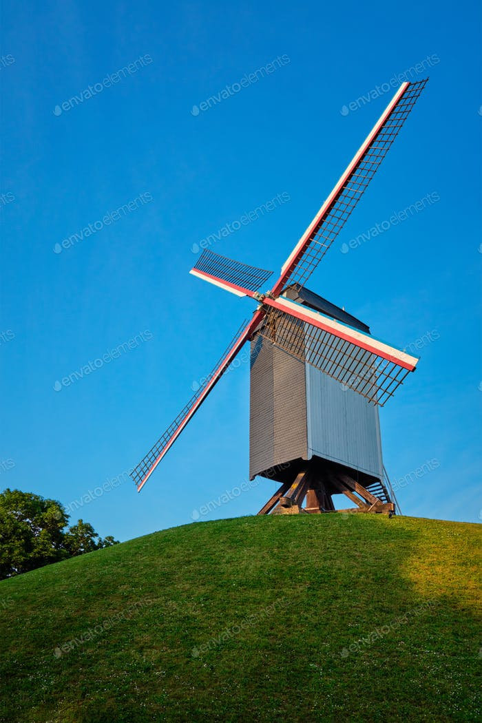 Sint-Janshuismolen Sint-Janshuis Mill windmill in Bruges on sunset, Belgium
