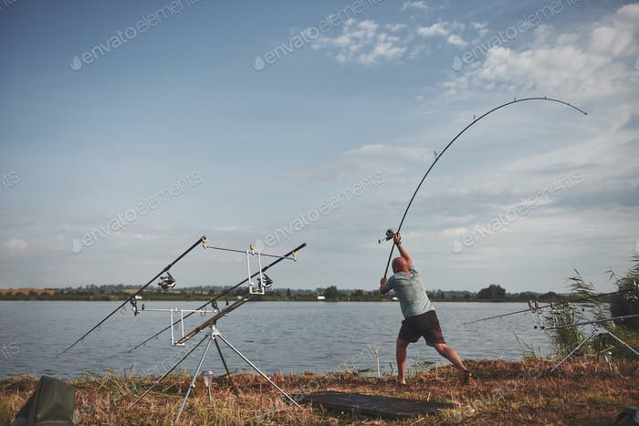 The fisherman throws a bait with bait. Today he will catch a big fish. Hunting and hobby sport