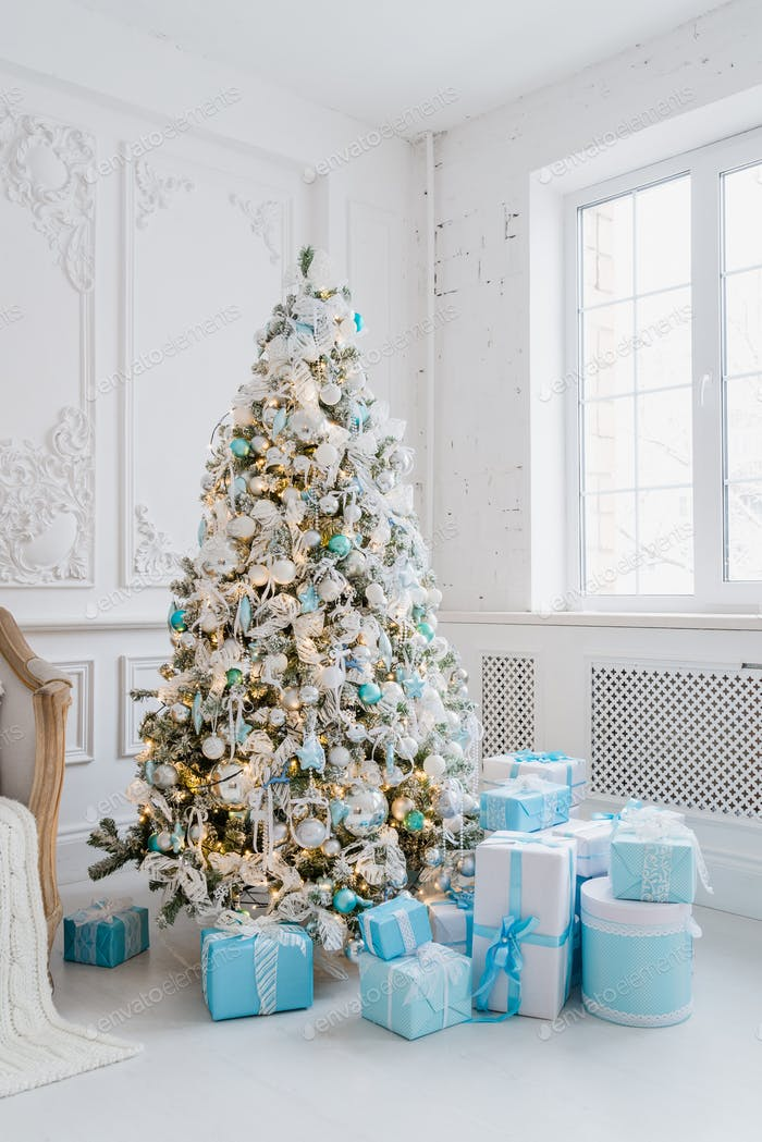 Christmas tree decoration at home interior with blue gift boxes