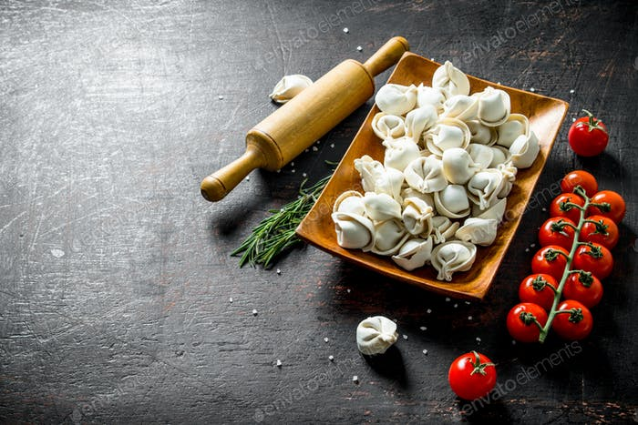 Raw dumpling with tomatoes and rosemary.