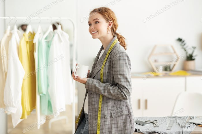 Running fashion business. Couturier girl drinking coffee