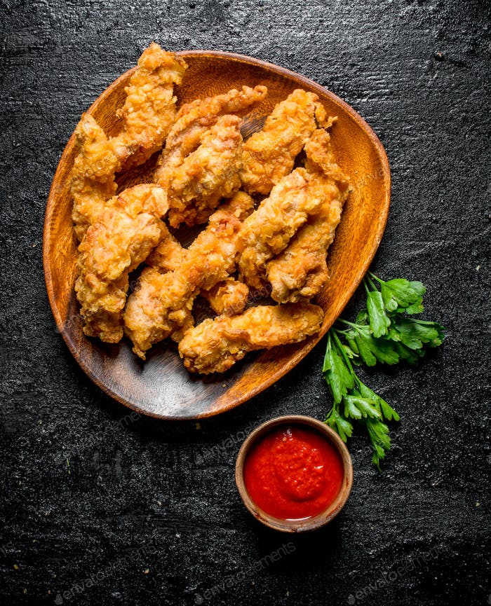 Chicken strips with tomato sauce and parsley.