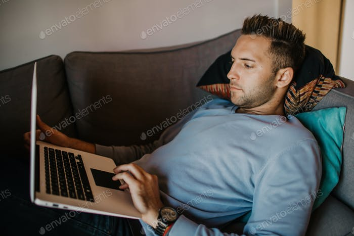 Handsome coworker man working at living room at home.